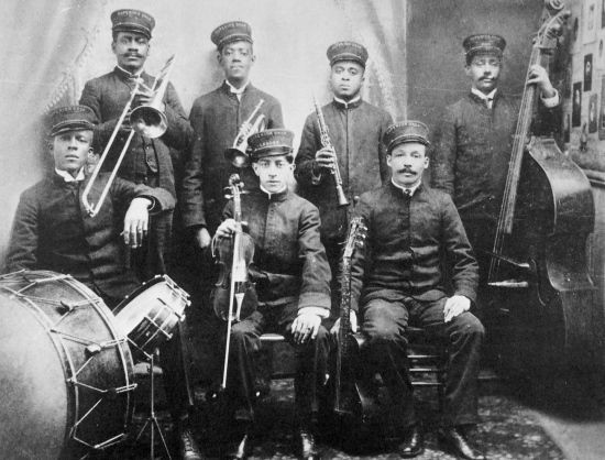 "Walter Brundy with the Superior Orchestra, 1920. No bass drum pedal is visible, but he most likely used one, or the ""double drumming"" technique."